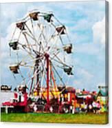 Ferris Wheel Against Blue Sky Canvas Print