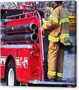 Fireman On Back Of Fire Truck Canvas Print