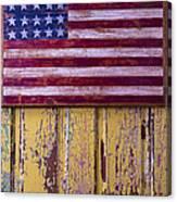 Flag On Old Yellow Door Canvas Print