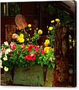Flowers And Shovel On An Old Drill Truck Canvas Print