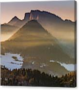 Fog Covered Mountains At Sunset Canvas Print