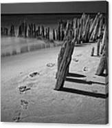 Footprints In The Sand Among The Pilings Canvas Print