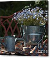 Forget-me-nots And Small Watering Can  Canvas Print