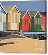 Four Beach Huts Canvas Print