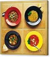 Four Dishes Of Different Food Canvas Print