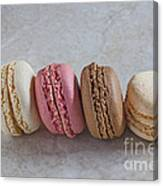 Four Macarons In A Row Canvas Print