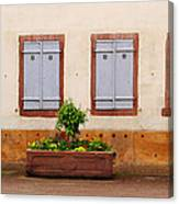 Four Pale Blue Shutters In Alsace France Canvas Print