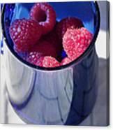 Fresh Raspberries In A Blue Cup Canvas Print