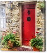 Geraniums By Red Door Canvas Print