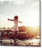 Girl Dancing On Beach At Sunset Sun Rays Canvas Print
