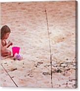 Girl In The Sand Canvas Print