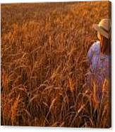 Girl With Hat In Field Canvas Print