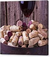 Glass Of Wine With Corks Canvas Print