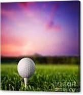 Golf Ball On Tee At Sunset Canvas Print