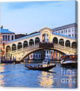 Gondola In Front Of Rialto Bridge At Dusk Venice Italy Canvas Print