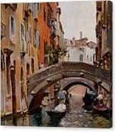 Gondola On A Venetian Canal Canvas Print