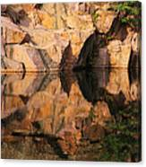 Granite Cliffs And Reflections In A Quarry Lake Canvas Print