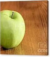 Granny Smith Apple On Table Canvas Print
