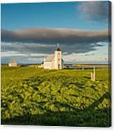 Grasslands And Flatey Church, Flatey Canvas Print