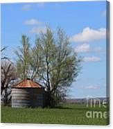 Green Wheatfield With An Old Grain Bin Canvas Print