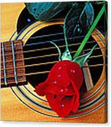 Guitar With Single Red Rose Canvas Print