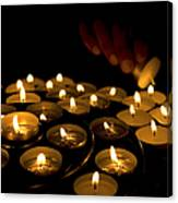 Hand Lighting Candles Canvas Print
