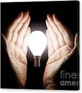 Hands Holding Light Bulb Canvas Print