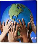Hands On A Globe Canvas Print