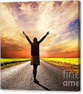 Happy Woman Standing On Long Road At Sunset Canvas Print