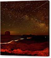 Headlights And Buttes In Monument Canvas Print