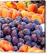 Heap Of Fresh Organic Peaches And Damson Plums  Canvas Print