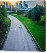 Highway Traffic Near A Big City Canvas Print