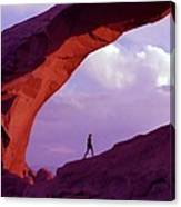 Hiker Beneath Arch Canvas Print