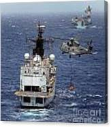 Hms Cornwall Is Pictured Receiving Stores By Merlin Helicopter  Canvas Print