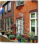 Homes Along The Canal In Enkhuizen-netherlands Canvas Print