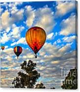 Hot Air Balloons Over Trees Canvas Print