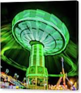 Illuminated Fair Ride With Blurred Neon Canvas Print