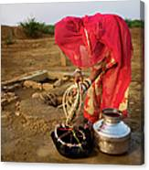Indian Woman Getting Water From The Canvas Print
