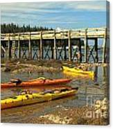Kayaks By The Pier Canvas Print