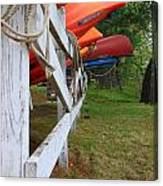 Kayaks On A Fence Canvas Print