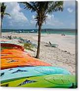 Kayaks On The Beach Canvas Print