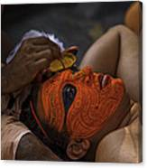 Kerala - A Theyyam-dancer Receives The Ornamental Face-painting Canvas Print