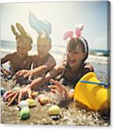 Kids playing in sea during summer Easter Canvas Print