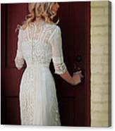 Lady In Edwardian Dress Opening A Door Canvas Print