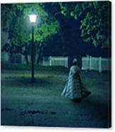 Lady In Vintage Clothing Walking By Lamplight Canvas Print
