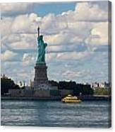 Lady Liberty And Water Taxi Canvas Print