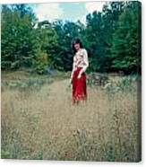 Lady Standing In Grass 2 Canvas Print