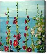 Lakeside Hollyhocks Canvas Print