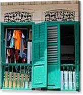 Laundry Hanging Seen Through Open Wood Shutter Windows Singapore Canvas Print