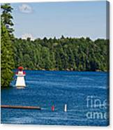 Lighthouse And Boathouse Canvas Print